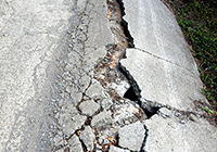 Image of an earthquake causing damage to a road.  Click to learn more about preparing for an earthquake.