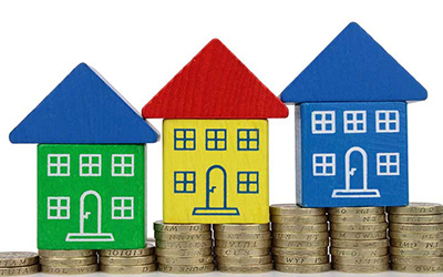 Image of toy houses on money. Learn about cash-out refinancing
