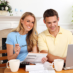 A young couple getting credit counseling online. Click for articles and videos about credit counseling.