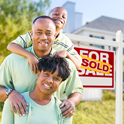 A family buying a home. Click for articles and videos about housing and mortgages.