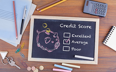 Image of a chalk board with 3 check boxes of credit scores. The box stating 'average' is checked.