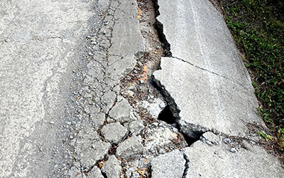 A road with a huge crack caused by an earthquake.