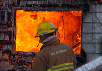 Image of a fireman working to put out a fire. Click to learn more about preparing for a fire