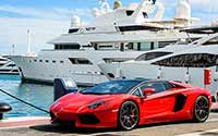 Image of a sports car and a yacht - unnecessary expenses for most of us.