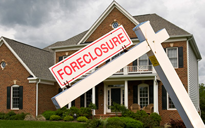 Foreclosure sign in front of a residence.