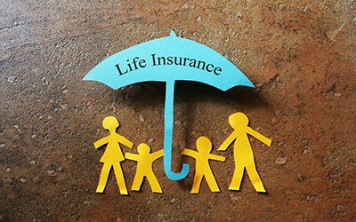 Illustration of a an umbrella with LIFE INSURANCE written on it, over a family of stick figures.