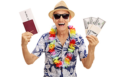 A goofy tourist holding airline tickets and a lot of money.