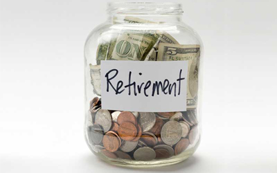 A jar with the word RETIREMENT on it filled with coins.