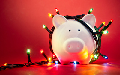 A piggy bank surrounded by holiday lights.
