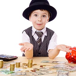 image of a young boy playing with money