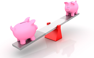 two piggy banks on a see-saw, one of them all the way to bottom illustrating uneven income.