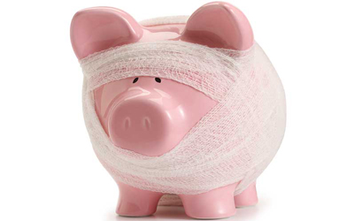 A piggy bank with bandages around it.