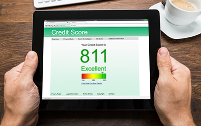 A tablet displaying a credit score of 811.